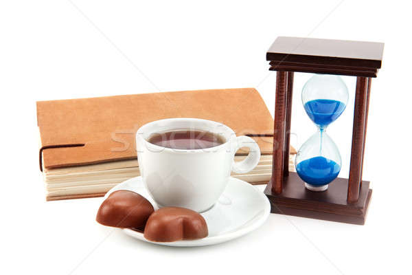 hourglass tea cup and a book on a white background Stock photo © alinamd