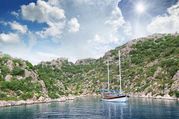 Stock photo: lagoon, sailing ship and mountainous coast