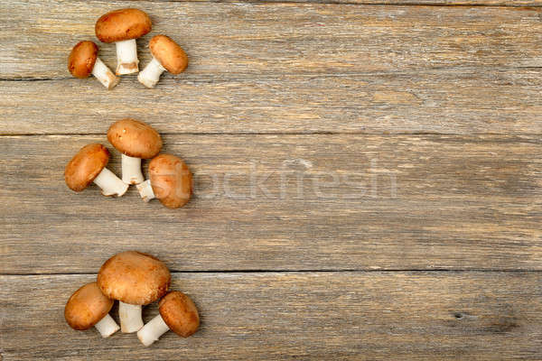 champignon mushrooms on a wooden boards background Stock photo © alinamd