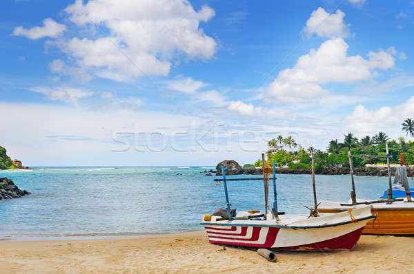 fishing boat on the sandy shore against a background the ocean a Stock photo © alinamd