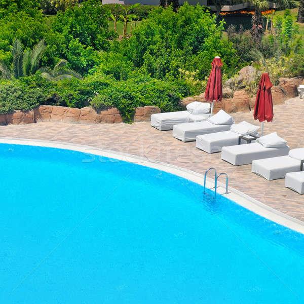 Swimming pool and lush vegetation Stock photo © alinamd