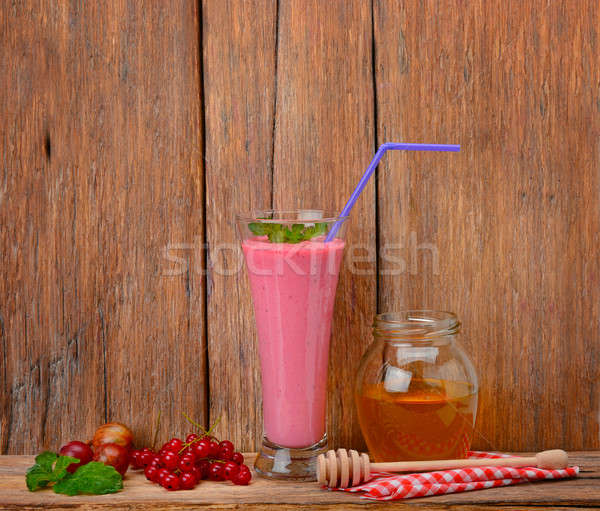 berry smoothie, currants, gooseberries and honey on a wooden sur Stock photo © alinamd