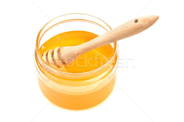 pot with honey and drizzler Stock photo © alinamd