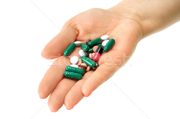 hand with pills isolated on white background Stock photo © alinamd