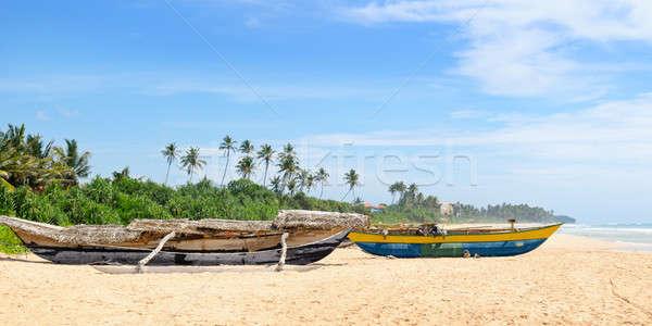 old fishing boat on the sandy shore Stock photo © alinamd