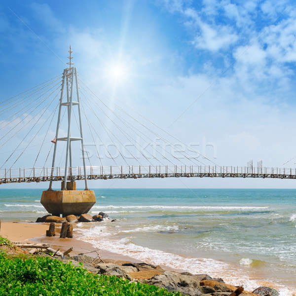 The bridge to the island, the ocean and the sun in the blue sky  Stock photo © alinamd