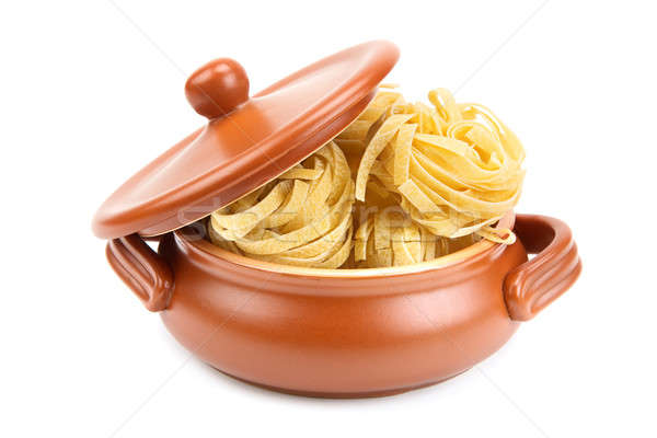 Spaghetti in a clay pot isolated on white background Stock photo © alinamd