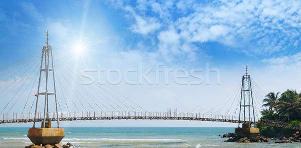 bridge to island, ocean and sun in blue sky Stock photo © alinamd