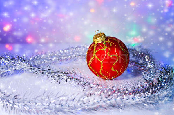 Red Christmas-tree ball and tinsel. Christmas decorations. Stock photo © AlisLuch
