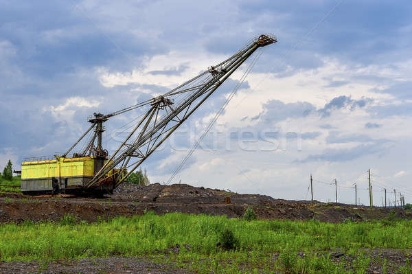 Excavator machine at excavation earthmoving work in quarry Stock photo © AlisLuch