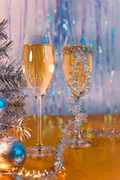 Glasses with wine, tinsel, Christmas tree and toys Stock photo © AlisLuch