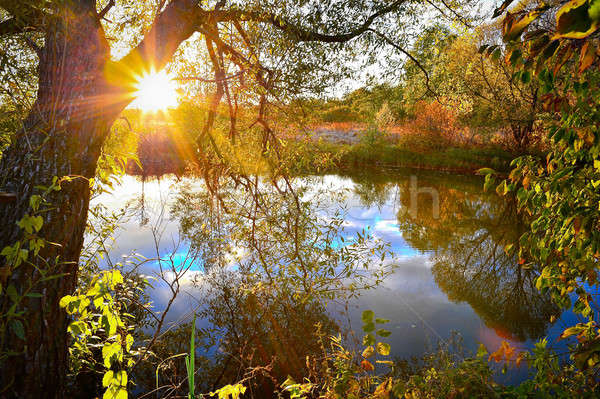 Colorful autumn sunset on the river Stock photo © AlisLuch