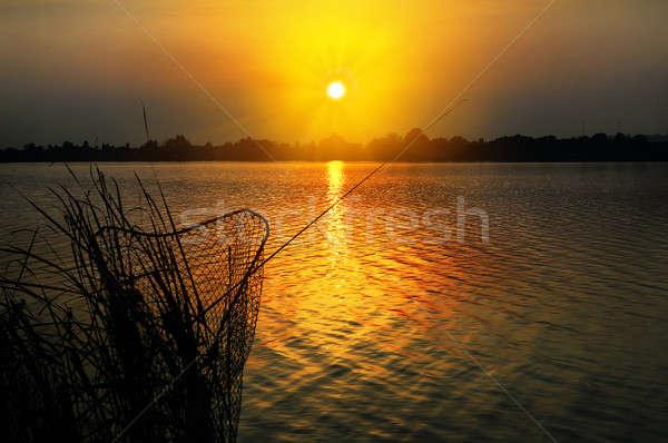 Сток-фото: удочка · цистерна · закат · озеро · рыбалки · ночь