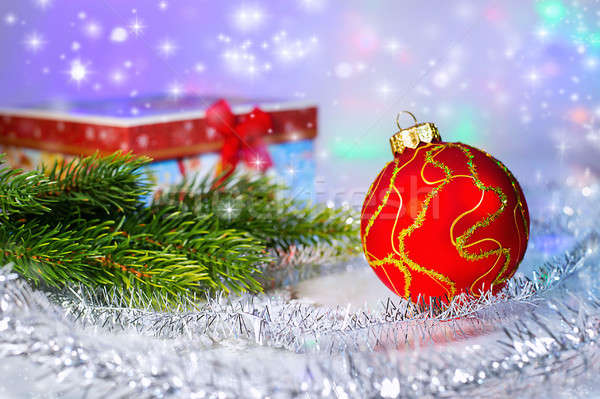 Red Christmas ball, fir branch and with gift box. Christmas deco Stock photo © AlisLuch