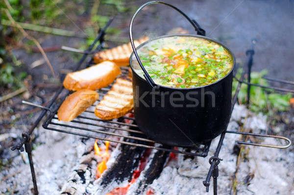 Főzés leves tűz kempingezés fű fa Stock fotó © AlisLuch