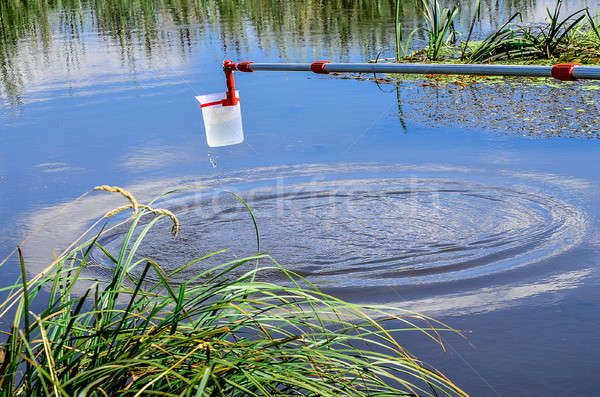 Take samples of water for laboratory testing. The concept - analysis of water purity, environment, e Stock photo © AlisLuch