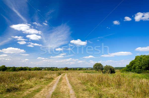 Landschap onverharde weg platteland najaar wolken natuur Stockfoto © AlisLuch