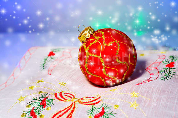 Red Christmas ball on a napkin. Christmas decorations. Stock photo © AlisLuch