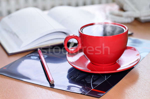 Red cup of coffee on the desk in the office Stock photo © AlisLuch