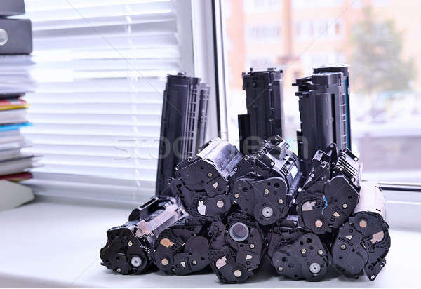 Cartridges from the printer stacked on the windowsill Office Stock photo © AlisLuch