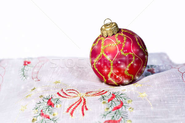 Red Christmas ball embroidered napkin isolated. Christmas decora Stock photo © AlisLuch
