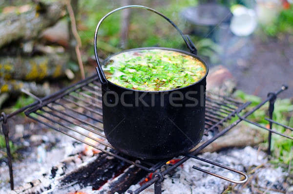 The cooking of soup on the fire Stock photo © AlisLuch