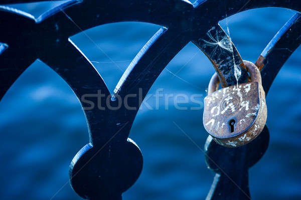 Love lock on the railing of the old bridge close up Stock photo © AlisLuch