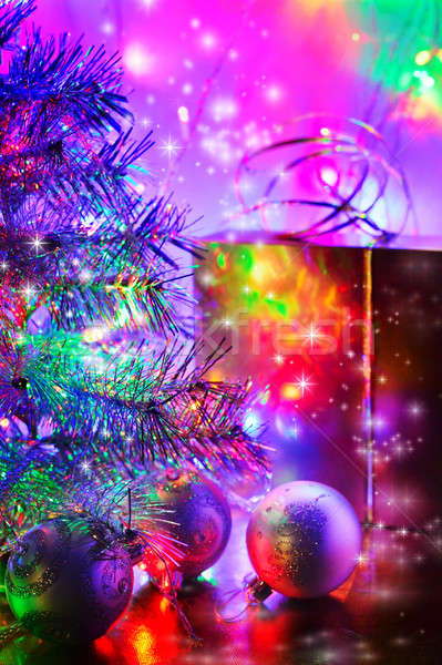 Christmas tree, balls, box, lit by fairy lights Stock photo © AlisLuch