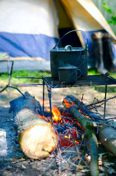 Tourist boiler mug and heated over a fire of wood Stock photo © AlisLuch