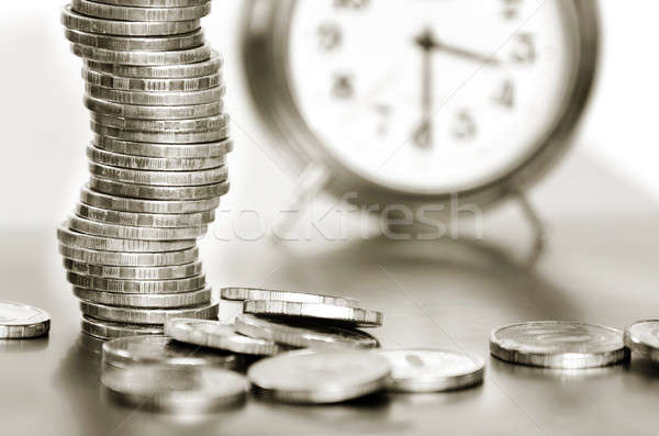 A stack of coins and alarm clock Stock photo © AlisLuch