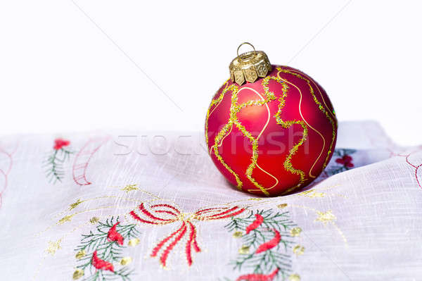 Red Christmas ball embroidered napkin isolated Stock photo © AlisLuch