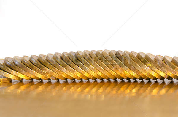 A number of coins lying on the Golden surface Stock photo © AlisLuch