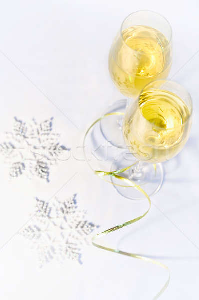 Two glasses of wine and snowflakes Stock photo © AlisLuch