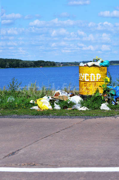 Overflowing barrel with rubbish and waste disposal on the waterf Stock photo © AlisLuch