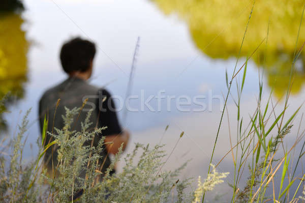 Blurred silhouette of fisherman on the river on a clear summer d Stock photo © AlisLuch