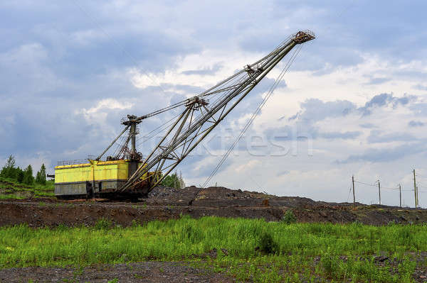 Excavator machine at excavation earthmoving work in quarry Stock photo © AlisLuch