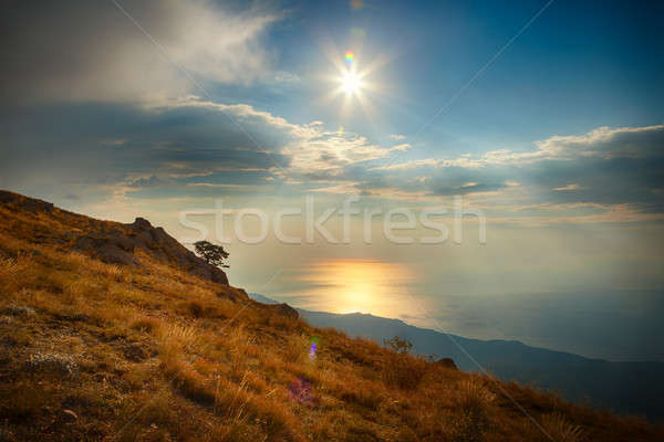 Hillside, sea and sky with clouds and sun Stock photo © All32