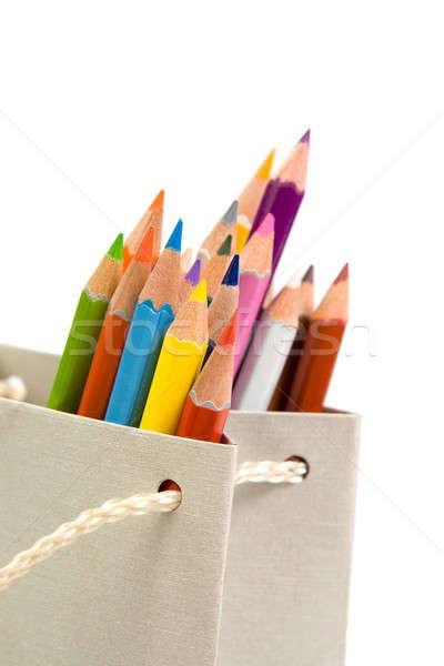 Kolorowy ołówki torby papierowe odizolowany biały streszczenie Zdjęcia stock © All32