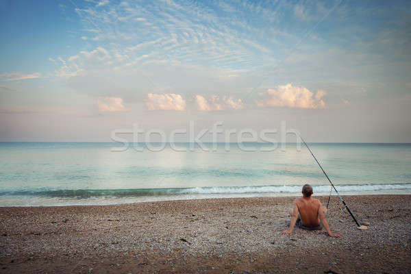 A fisherman on the beach in the morning Stock photo © All32