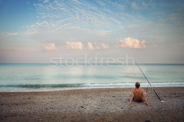 Pescador playa manana caña de pescar deporte puesta de sol Foto stock © All32