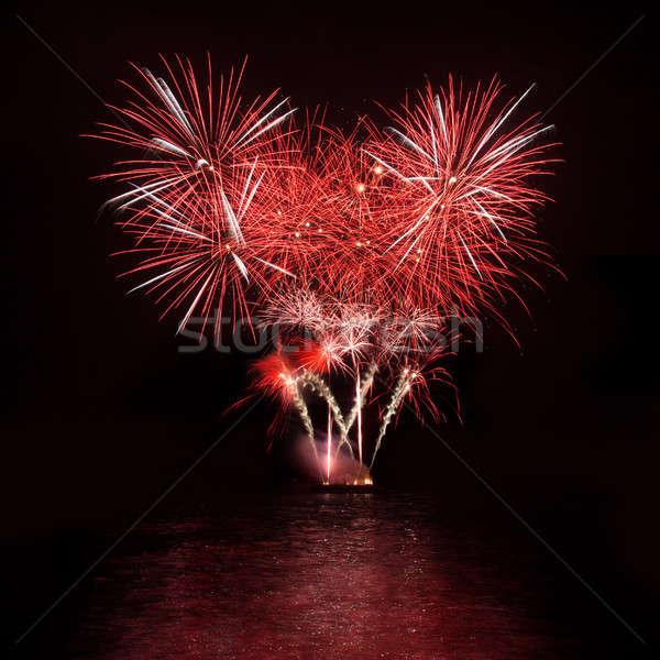 Fuochi d'artificio cielo notturno colorato cielo acqua arte Foto d'archivio © All32