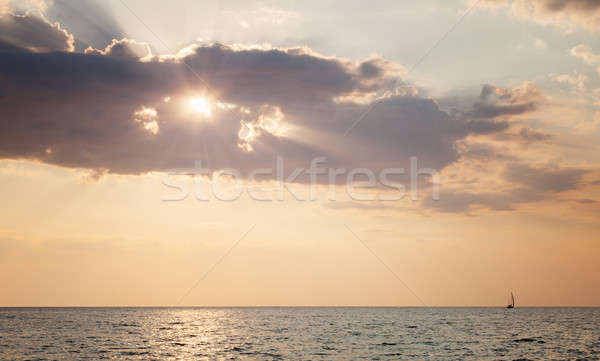 Stock photo: Boat sailing on the sea at sunset