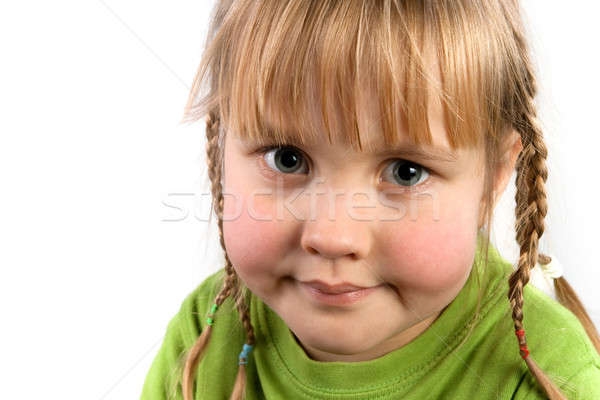 Face a little girl with pigtails closeup Stock photo © All32