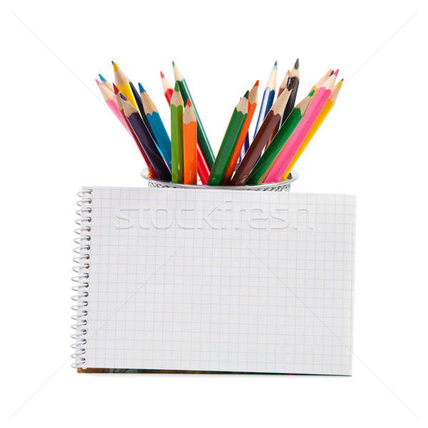 Colored pencils and an open notepad Stock photo © All32