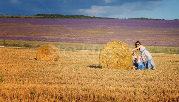 Mother with children on the field with hay Stock photo © All32