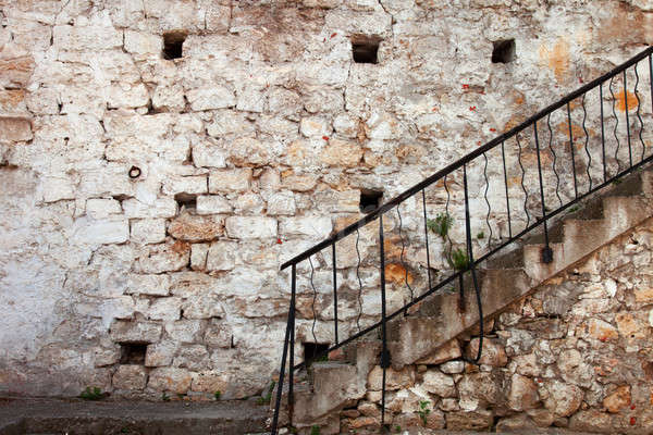 Stairs with railing against the old stone walls Stock photo © All32