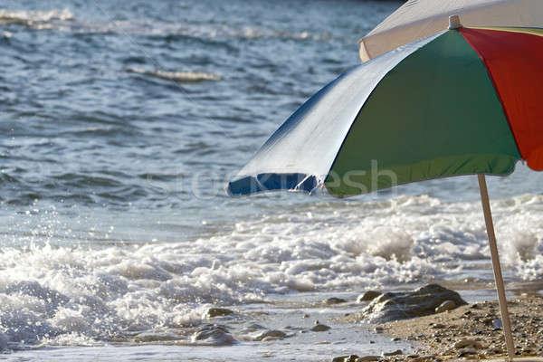 Ombrellone acqua blu sabbia divertimento tropicali Foto d'archivio © All32