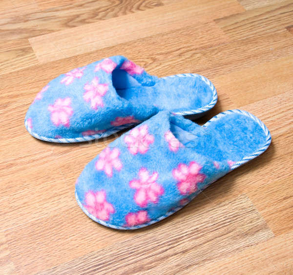 Fluffy domestic slippers on the parquet Stock photo © All32