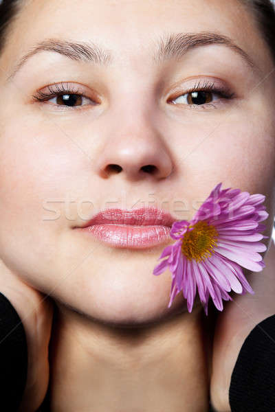 Portrait of a young girl with flower Stock photo © All32