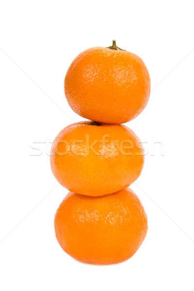 Pyramid of mandarins. Isolated on white background. Stock photo © All32